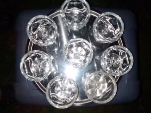 Round silver coloured tray with 8 glass bowls