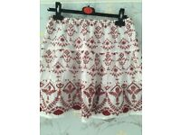 Cotton white and red short skirt with labels