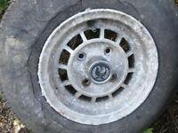 old ten inch alloy wheel for reliant robin and door