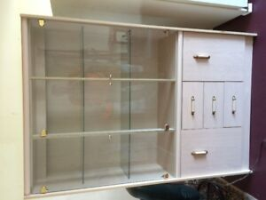 Glass cabinet with drawers and light