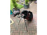 Full set LEFT handed Taylor Made Golf Clubs plus putter and Titleist Driver