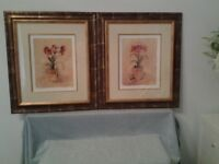 A pair of framed pictures
