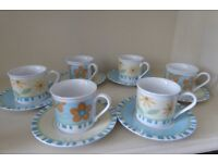 A set of 6 expresso cups and saucers
