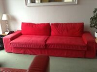 IKEA three seater bed settee in red. Hardly used. Good condition. Very comfortable.