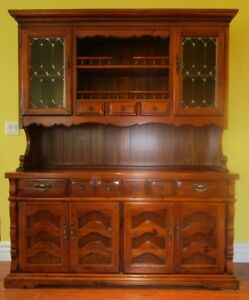 Elaborate two piece china cabinet