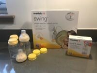 Medela Swing Breast pump with extras - never used