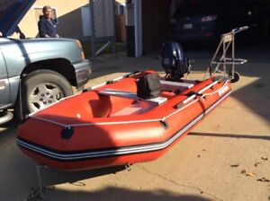 11 Ft Inflatable Boat and Motor for sale!