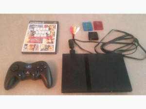 PS2 Slim with Logitech wireless controller,2 8gb cards and GTA