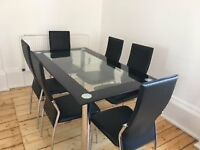 Dining table and 6 chairs - Glass table and faux leather chairs