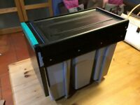 Pull-out kitchen waste bin.