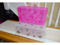 Plastic storage boxes for shoes/boots.