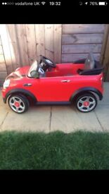Children's battery powered red mini