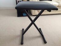 black piano/keyboard stool