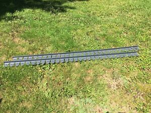 Two pieces of heavy duty walkway edging