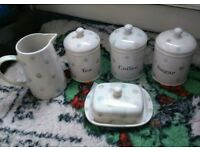 Tea, cofffee, sugar, butterdish, milk jug
