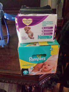 Diapers NB and size 2