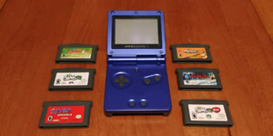 Game Boy Advance SP Blue with Charger and 6 games.