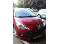 2011 red peugot lovely car good runner.