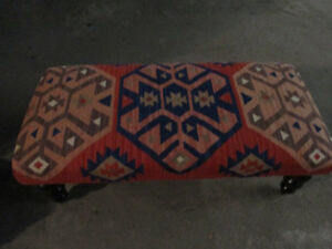 Ottoman/bench seat designed with an Indian style rug upholstered