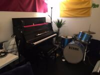 Fully equipped studio with upright piano ideal for producers, singers and songwriters