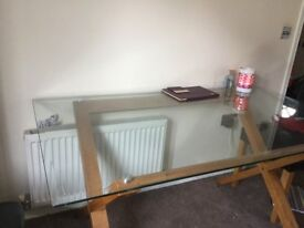 Glass and solid oak dining room table with four chairs