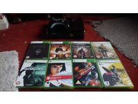 Xbox 360 slim, 8 games & pad.