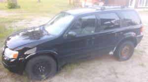 2003 black ford escape.