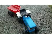 Ford Toy tractor with pedals and trailer,