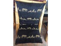 Large bamboo chairs with handmade cushions and table