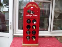 WOODEN RED UNUSUAL WINE BOTTLE STAND WITH OVER CUPBOARD