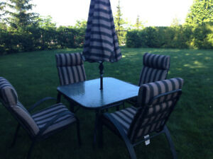 Patio table, chairs and umbrella