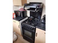 Gas cooker with upright grill.