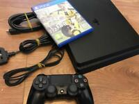Latest slim version PS4 with FIFA 17 less than year old