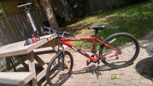 Mongoose Frontier bicycle (red and black)