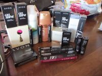 bundle of avon products make up and skin care and fragrance
