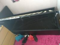 Single side lift black faux leather ottoman bed w/ mattress & memory foam topper - Offers considered