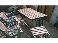 TABLE AND CHAIRS AND FOOT STOOL CAST IRON ENDS