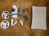 Nintendo Wii with controllers and Wii fit board