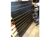 Shop slat boards with inserts , mirrors, and changing room foldable doors.