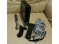 Black Nintendo Wii console and accessories