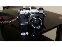 Olympus OM10 camera including 3 lenses,carry case and accessories