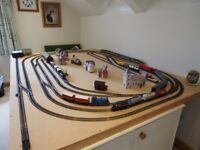 Model Train layout 00guage with trains, carriages, buildings and electrified points for 3 circuits