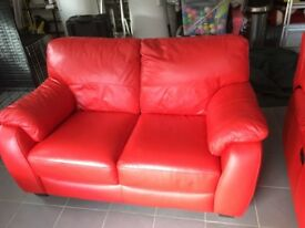 Red leather sofa and matching recliner armchair