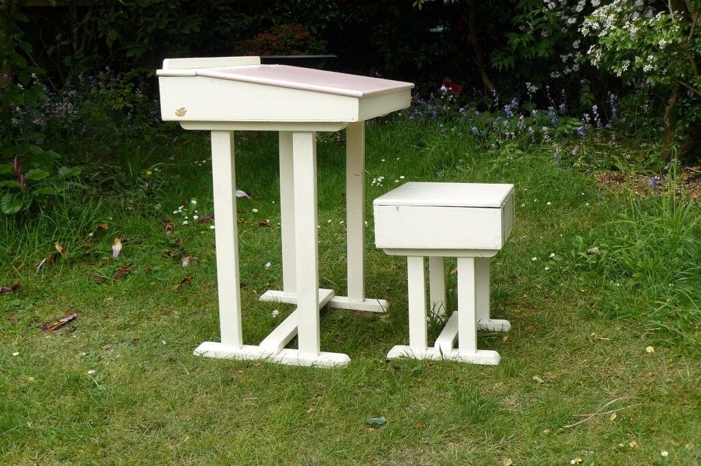 Desk and chairin Uxbridge, LondonGumtree - Desk and chair made of wood suitable for a child of about 6 upwards. Both desk and chair have storage space under the lids. The desk lid is painted pink but can be re painted if preferred