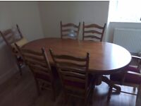 Solid wood 6 seater dining table with cushioned chairs