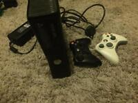 Xbox 360 comes with 2 controllers and14 games very good condition
