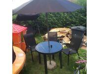 Table chairs set plus umbrella