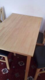 Dinning table and 4 chairs good condition