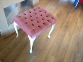 Dresser stool covered in pink