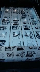 Camera wallpaper covered chest of drawers